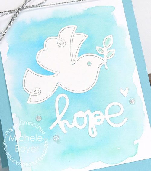 Paper Smooches Dove and Religious Words 2 dies (close-up)